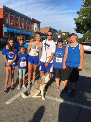 Croswell-Lexington High School gradute Brooke Smith poses with her family at the Lexington 5K.
