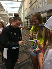"Hali Flickinger signs autographs for young fans on the night she qualified for the U.S. Olympic team at the U.S. Olympic Team Trials in Omaha, Neb. ""Honestly none of those kids probably even knew who I was, but it was cool,"" Flickinger said."