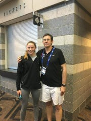 Olympian Hali Flickinger poses with her former coach Michael Brooks, who coached her from age 11 through age 18 at the York YMCA Aquatic Club.