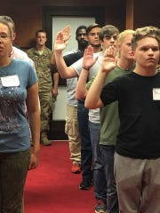 Army recruits participate in a swearing in ceremony to become U.S. Army soldiers.