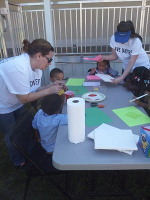 Helping out at Head Start during United Way's 2015 Day of Caring.