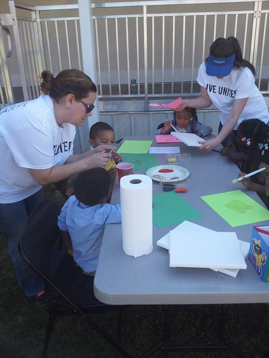 636060076781770099-Helping-out-at-Head-Start-Day-of-Caring-2015.jpg
