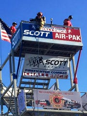 """Local firefighter Justin Weaver competes in a Scott Firefighter Combat Challenge event in 2015. The event, which is billed as """"The toughest two minutes in sports,"""" is coming to the Pataskala Street Fair."""