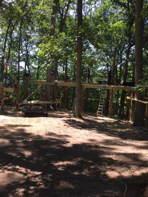 A film crew from DIY's Treehouse Guys is at the North Star Reach Camp in Unadilla Township this week building a tree house and zip line.