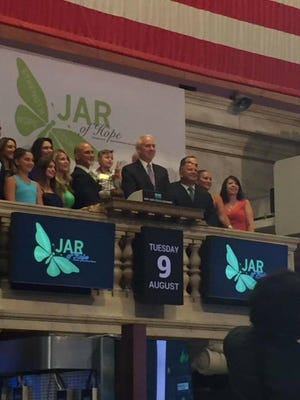 JAR of Hope supporters gather to ring the closing bell of the New York Stock Exchange Tuesday.