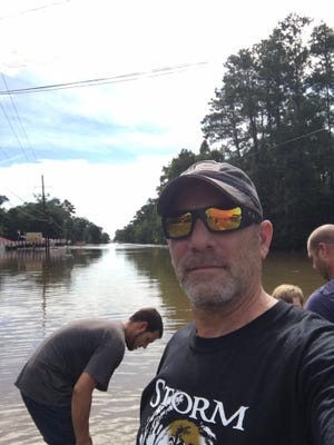 Clyde Cain takes a selfie in front of some of the floodwaters that devastated southern Louisiana over the weekend.