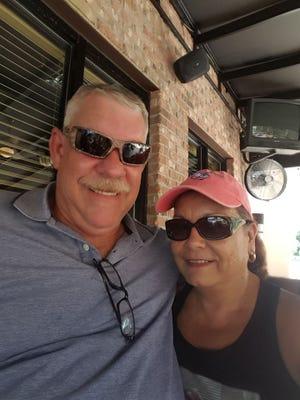 Ellen Cruz Stevenson, left, with her husband Bob, live in Denham Springs, Louisiana, recently ravaged by flood waters.