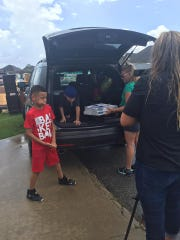 Carson and the community delivered more than 300 pizzas to flood victims.