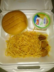 This photo taken by a shelter resident depicts food served for lunch Aug. 23 at the Heymann Center emergency shelter in Lafayette managed by the American Red Cross. Residents have complained about inadequate and unappetizing food since the nonprofit took over the shelter.