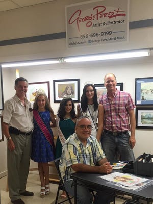 (From left) Alex Kaganzev, National Miss Amazing Preteen Rylee Howerton, Miss Cumberland County Olivia Cruz, Miss Vineland Alyssa Rodriguez, Russ Swanson,  director of Vineland Downtown Improvement District, visited George Perez (seated) at his art gallery and other entrepreneurs at The SPOT in Downtown Vineland.