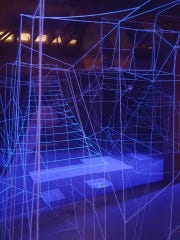 """Sabrina Barrios' """"Coup D'etat"""" installation was created using UV light and string."""