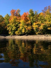 Fall colors are brilliant along Indian Lake beside Route 30 in the southern Adirondacks in New York in 2014.