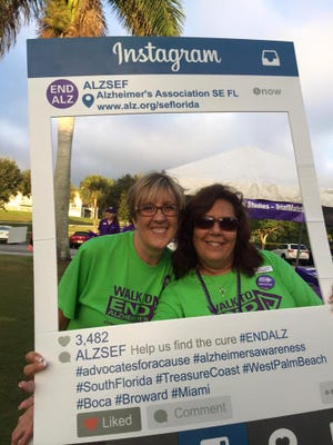 Walk co-chair Donna McMillan and board member Debra Thompson pose at last year's Treasure Coast Walk to End Alzheimer's at Indian RiverSide Park.