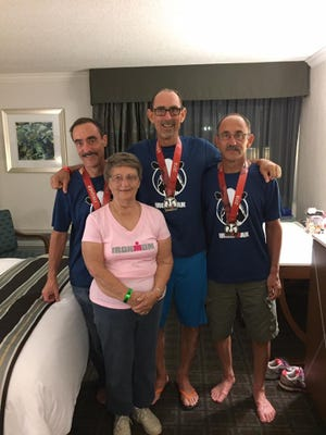 The Ward brothers pose with their mom, Gloria, after running in the Wisconsin Ironman last weekend.