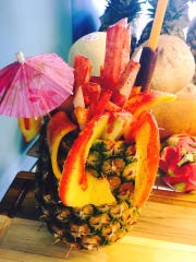 Pina Loca is a whole pineapple filled with mango sorbet and garnished with fresh fruit at Fresko Pops and Eatery in Murfreesboro.