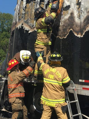 Crews from multiple local fire departments respond to a wreck and fire involving tractor-trailers on Interstate 24 Thursday.