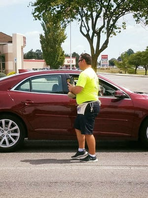 Captain Charles Amspacher is shown collecting donations during the recent Fill the Boot event.
