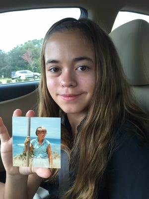 Jenna Stilling, daughter to Montgomery Advertiser reporter Kym Klass, holds a photo of Pam Klass, her grandmother who died from breast cancer in 1988.