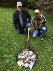Paul Whalen and Tom with a nice mixed bag of crappies