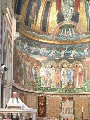 Father David Killeen of St. John's Episcopal Church delivers a sermon in Rome.