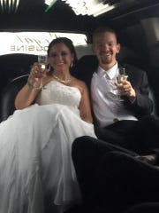 Gina and Tim Yarbough toast in their limo on their