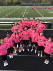 Madison cheerleaders form a pink ribbon ahead of the