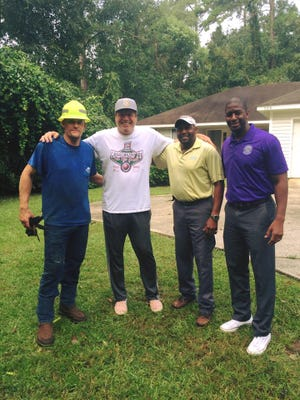 The staff of Rowe Roofing pose with Mayor Gillum.