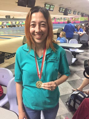 Teresa Seats displays her medal from the Special Olympics bowling tournament on October 29', 2016 in Las Cruces. Seats was one of several Deming athletes to bring home medals form the games. 16 Deming Roadrunners Special Olympics athletes participated in the bowling tournament and proudly brought home medals.The tournament marks the final event for the Roadrunners each year as they look forward to the Games, the closing night banquet and victory dance.  Anyone interested in joining the Deming Roadrunners for our 2017 bowling season should contact the local coordinator Adele Moreno for more information at 544.4299. The team bowls at Starmax, 333 N. Country Club Rd., on Tuesdays from 5 - 7 p.m. Dates for the 2017 season have not been announced.   The public is invited to Starmax to watch us bowl.  We have a great time and the athlete's enthusiasm is infectious!