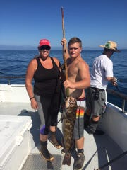 Sunny Jody O'Neil, left, from Oxnard, caught a 10-pound lingcod aboard the Gentleman.