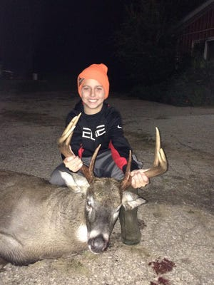 "Weston Tousey, age 11, son of Chris and Jen Tousey of Greenville shot this buck, his first deer, during the youth hunt. The deer was harvested in Oconto County at his grandparents, John & Judie Sylvester's, farm. The buck is an 8 pointer with a 16"" spread and weighed 210 lbs dressed. He had help tracking it from his mom, dad, Grandpa, sister Hannah, and brother Nathan."
