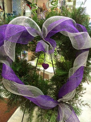Free boughs of evergreen and dried garden materials can by used to make interesting wreaths.