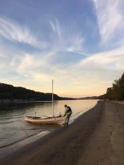 John Guider pulls his boat, Adventure II, onto the