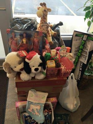 New, unwrapped toys were collected at the Daily Tribune office for the 2015 Toys for Toys drive.