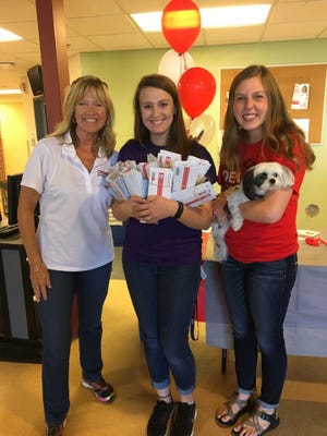 Allie Thiesse (center), a University of Sioux Falls student, has organized three bone marrow donor drives after learning that family friend Tom Rokahr was diagnosed with a form of blood cancer at age 8.