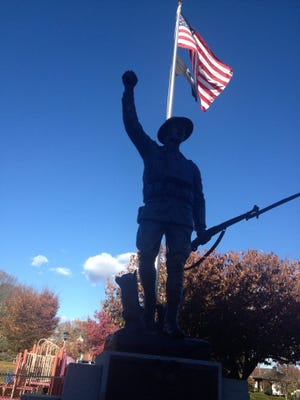 The new doughboy statue has been erected in Ma Riis Park on Veterans Day.