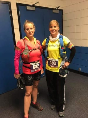 Chambersburg's Dawn Naugle, left, and Monica Olszewski take a pre-race photo before competing in the JFK 50-Mile run last weekend.