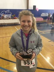 Lily Showalter of Chambersburg, 10, clocked a 7:53 to win the one-mile run at last weekend's Sophie's Six 6K Run, held at Wilson College.