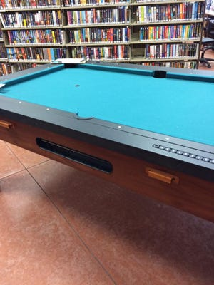 A Classic Sport 3-in-1 table has pool, hockey, and ping pong and will be available at Capitan Public Library's silent auction Saturday. Valued at $600, bids start at $200.