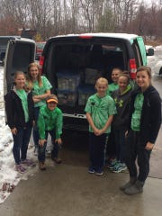 Peyton's Promise advocates load up a van with donations for Blessings in a Backpack.