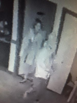 The Sartell Police Department is investigating a burglary that took place at Cornerstone Buffet . Surveillance cameras captured a man and woman in the restaurant overnight when the burglary took place.