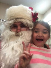 Scotty Robinson, dressed as Santa, and his daughter