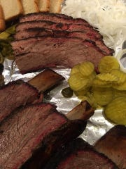 A platter of brisket, beef ribs, pickles and white bread from Pit Commander BBQ.