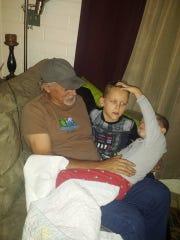 Daniel Calhoun, 61, plays with his grandchildren, Andrew