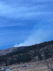 A 20-acre wildfire burns near Bobcat Ridge Natural Area, west of Fort Collins, on Thursday evening.