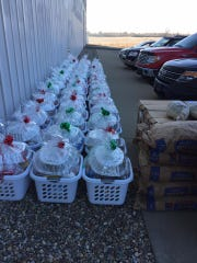 Floyd's Supermarket was able to prepare and gift wrap around 40 baskets for EZ Access employees.