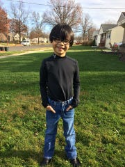Nine-year-old Jon Paul Corman of Barrington was adopted from China when he was 3 1/2 years old. After corrective surgery and glasses, the Barrington resident can see colors and shapes.
