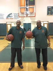 Jerry Humphries, right, is the owner of H&H Smokehouse and junior varsity coach at FAMU DRS.