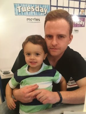 """Thomas """"Tommy"""" Ryan, pictured with his son Jack, was fatally struck by a train at Ramsey's Main Street station in June 2016."""