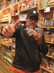 Actor Jeffrey Dean Morgan, a partner at Samuel's Sweet Shop in Rhinebeck, poses with a cookie of The Walking Dead inside the store in a photo dated Oct. 21, 2016.