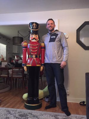Noah Garguile stands next to his nutcracker, which vanished from his front porch, then was returned Christmas Eve.